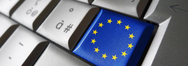 European Union and EU community parliament concept with EU flag on a computer key.